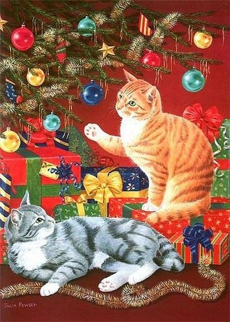 cats love Christmas balls  (By Julia Pewsey) / Mine loves to slap at the lights