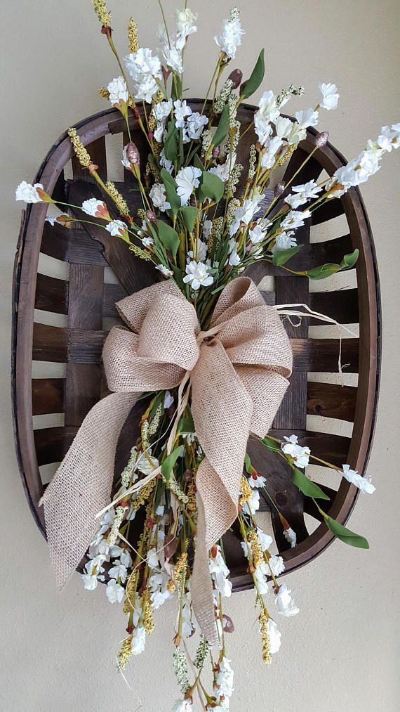 Tobacco arrangement. This beautiful basket arrangement would make a great statement on the wall or on a coffee/dining table. They perfect for the farmhouse decor, shabby chic home, rustic primitive home accent, the possibilities are endless. A great way to accentuate that classic look in any room. Use one as a mantle center piece or to set on the coffee table.Make this the next addition to your Farmhouse style decor. Flowers in picture not included. Measurements 15 W X 29 L X 10 D