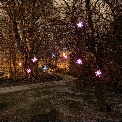 """Mr. Light 44254 Solar Starburst """"Curtain Light"""" Garland with Slow Color Changing LED's, 10-Piece by Mr. Light. $99.99. 3 by 1300mA Ni-MH Batteries. 31-inch spacing between each bird. 10-foot lead wire from solar panel to first starburst. Total length 33-foot. Ten 4-inch Wide Molded Acrylic Starbursts Attached By a Clear Wire to One High Efficiency Solar Panel.  Each Starburst with a Slow-Transitioning Color Changing LED Hangs Down From The Top Clear """"Curtain Wire"""" ..."""