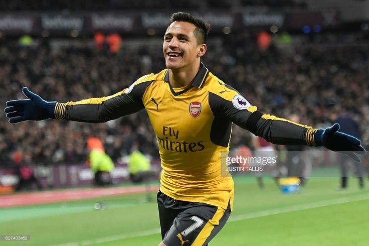 Arsenal's Chilean striker Alexis Sanchez celebrates after scoring their second goal during the English Premier League football match between West Ham United and Arsenal at The London Stadium, in east London on December 3, 2016. / AFP / Justin TALLIS / RESTRICTED TO EDITORIAL USE. No use with unauthorized audio, video, data, fixture lists, club/league logos or 'live' services. Online in-match use limited to 75 images, no video emulation. No use in betting, games or single club/league/player…