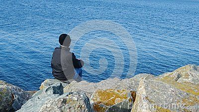 Woman relaxing sea shore ocean dam, looking on horizon, deep blue calm water