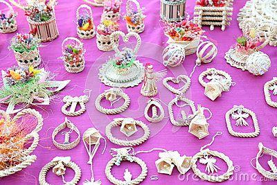 Twisted straw crafts - decorative handmade straw on pink background.