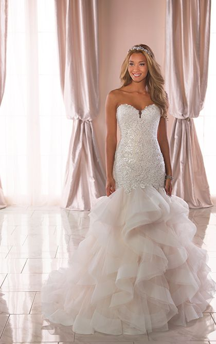 22fe56896483 Trumpet style fit and flare. Ruffle bottom finished with a horsehair trim.  Beaded lace bodice.