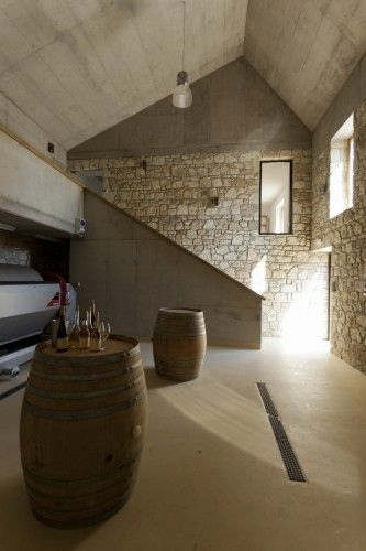 This is a great redesign of an existing structure complimented with new elements. I happen to enjoy this cold industrial interior. Füleky Winery - Építész Stúdió Tokaj, Hungary - Building of the Year 2011 photographed by Gyula Erhardt