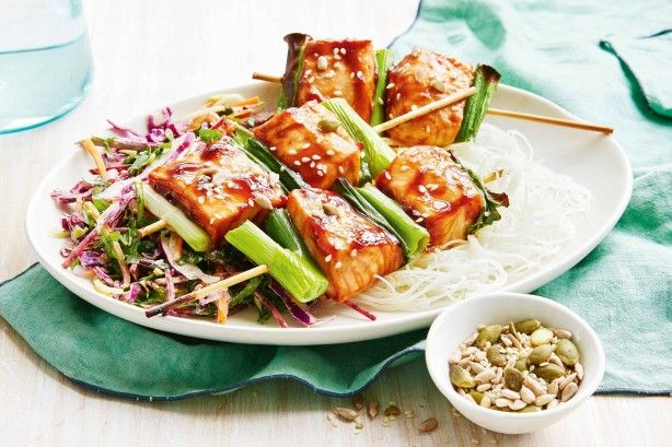 Have dinner on the table in under 20 minutes with these tasty teriyaki salmon skewers served with rice noodles and kale slaw.