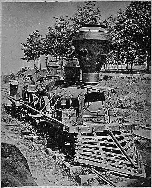 Locomotive destroyed by Confederates in evacuating Atlanta. September 1864