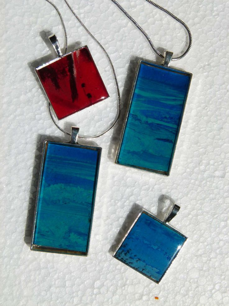 Four of my hand-painted images, set in resin, in a silver bezel.  See more at jackiesimmondsstudio on Etsy