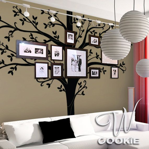 I like the idea of the family tree with picture frames, not sure if I love the lanterns.  Found at etsy.com.