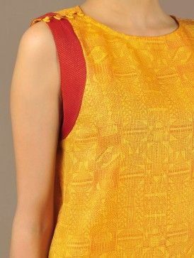 Yellow Kota Silk Top with Brocade Pacific Print -- handwoven geometric print Kota silk top with cotton lining has been hand block printed. Silk brocade trim detailing along the armhole and loop-buttons on the shoulders.