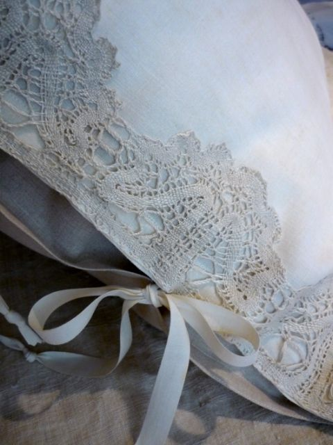 White linens with cream lace trim and ties.