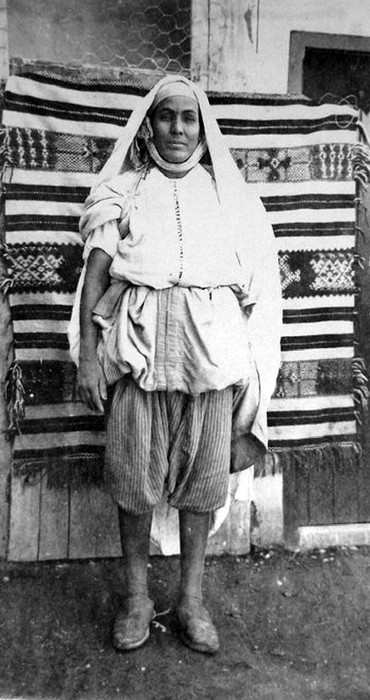 "Africa | ""FEMME MAROCAINE EN TENUE DE VILLE MARRAKECH"" | Morocco. 1933 | Photographer unknown"