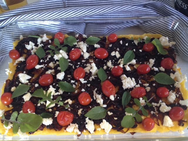 Polenta Pizza with Caramelized Onions Cherry Tomatoes and Feta