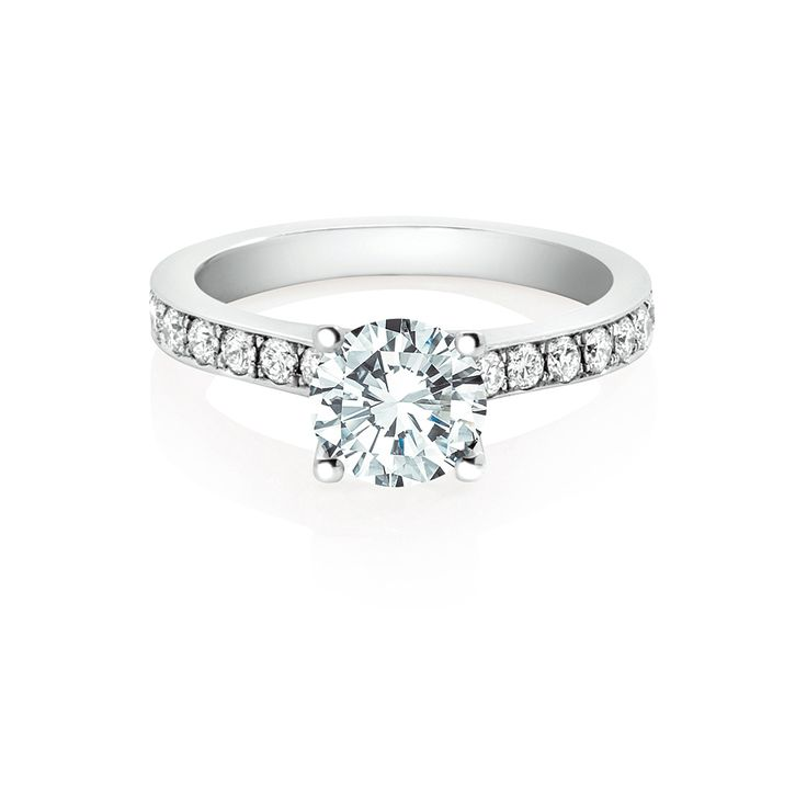 One of our most sought after designs, a pave set diamond band delicately accentuating an elegant Amira solitaire. A perfect example of classic yet modern simplicity.