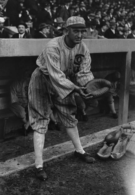 SHOELESS JOE: This is a 1919 photograph of Chicago White Sox baseball player Shoeless Joe Jackson in an unusual stance posing with a glove and catcher's equipment nearby. Jackson never played catcher. With the exception of 27 games at first base for Cleveland in 1915, he was always an outfielder.