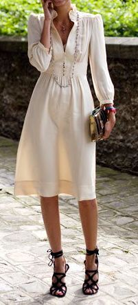 This cream silk dress is stunning! But what makes it truly amazing are its accessories: a perfect clutch that doesn't overpower the ensemble, along with gorgeous shoes and an equally gorgeous long, simple, sleek necklace to complete the look.