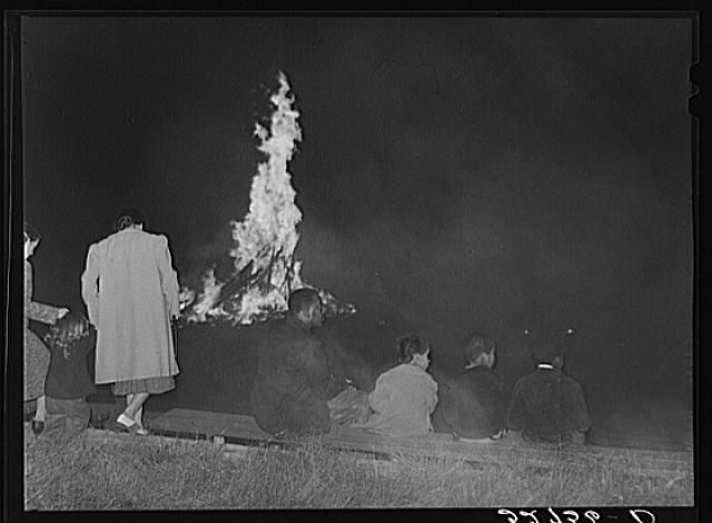 Some of the townspeople on the University of North Carolina campus in Chapel Hill, Orange County, North Carolina at a pep rally the night before the Duke-North Carolina game which was played in the Duke Stadium in Durham, North Carolina