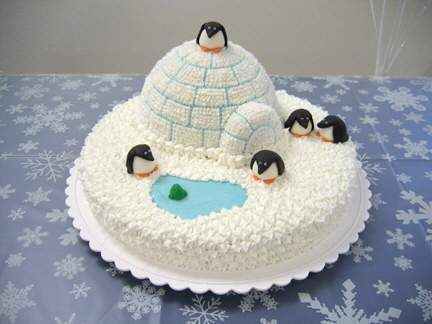 "Igloo with penguins Martha Stewart igloo cake pan on top of a 16"" round.  Penguins, fish, and pond are fondant, everything else buttercream."