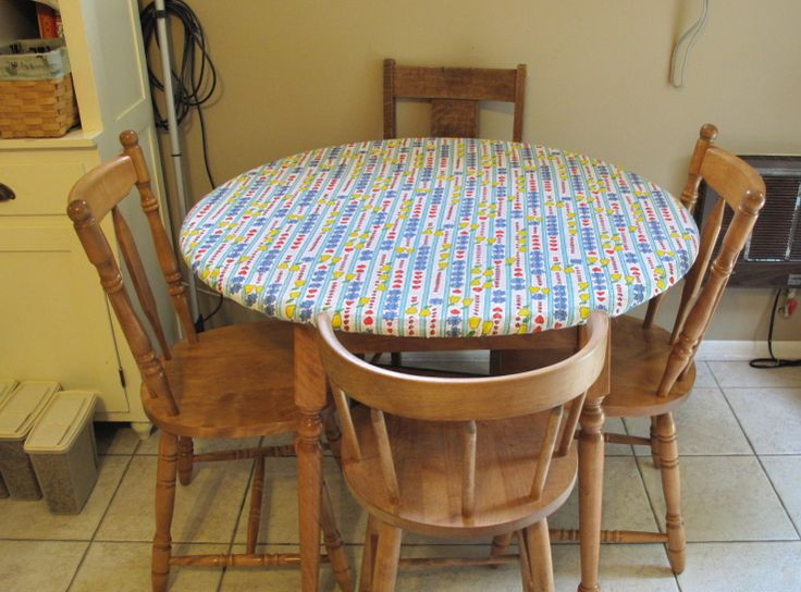 Easy Peasy table cloth that won't slip off or get caught in your clothing when you stand up. Great when you have kids around! Also good for picnic tables, just sew a rectangular one instead of round.