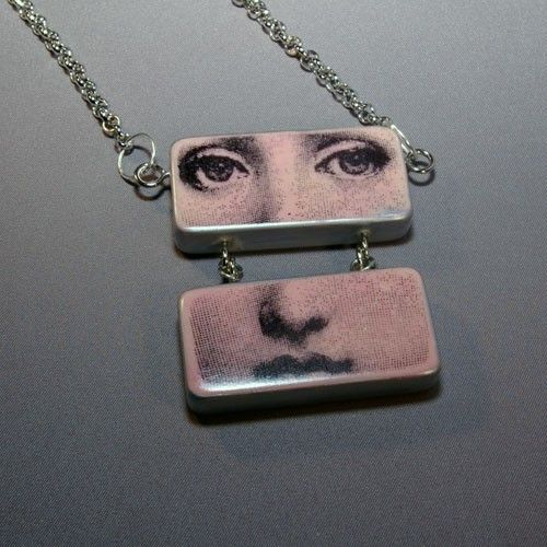 The latest addition to my store. Face necklaces made from two jumbo dominoes.  Kind of reminds me of those art doll pendants I've always admired. $45