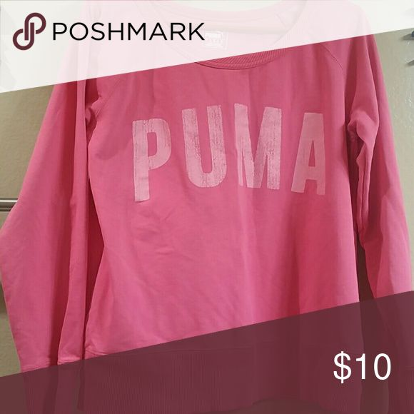 Puma sweatshirt Pink puma sweatshirt. The word PUMA top came with the word like this distressed or cracked look. It has been worn once and washed once.bought it from j.c penny Puma Other