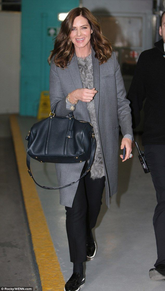 Smiling broadly as she emerged from her private car, the friend of Charles Saatchi was evi...