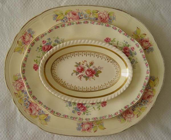 collection of vintage platters, pink roses,