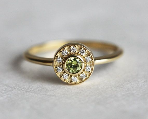 Halo diamond peridot ring. This is a listing for yellow gold peridot engagement ring with 10 pave diamonds around . This item is handmade . It is a