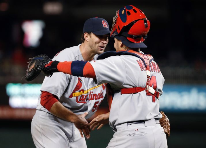 starting pitcher Adam Wainwright celebrates with catcher Yadier Molina after a baseball game against the Washington Nationals at Nationals Park. Wainwright threw a two-hitter as St. Louis won 8-0. 4-17-14