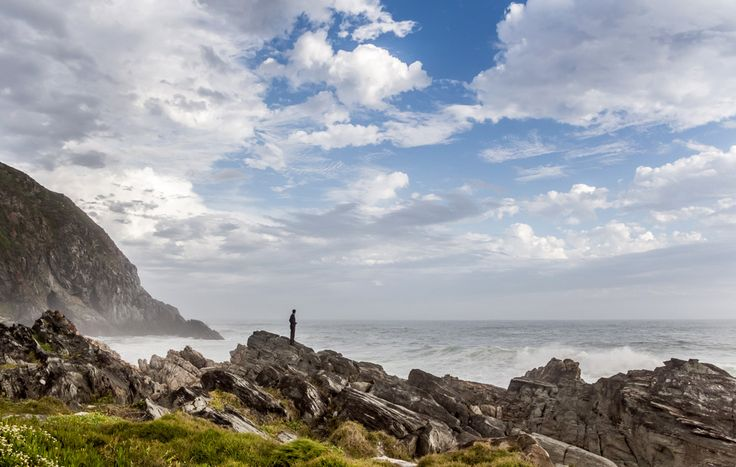 A friend checks out the stormy seas. Photo taken from the Oakhurst hut boma. Photo by Chris Davies.