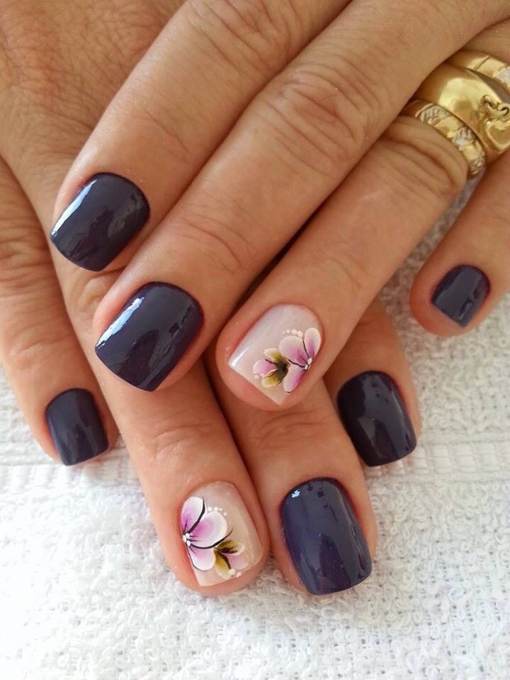 Navy blue and pink with flower nail design