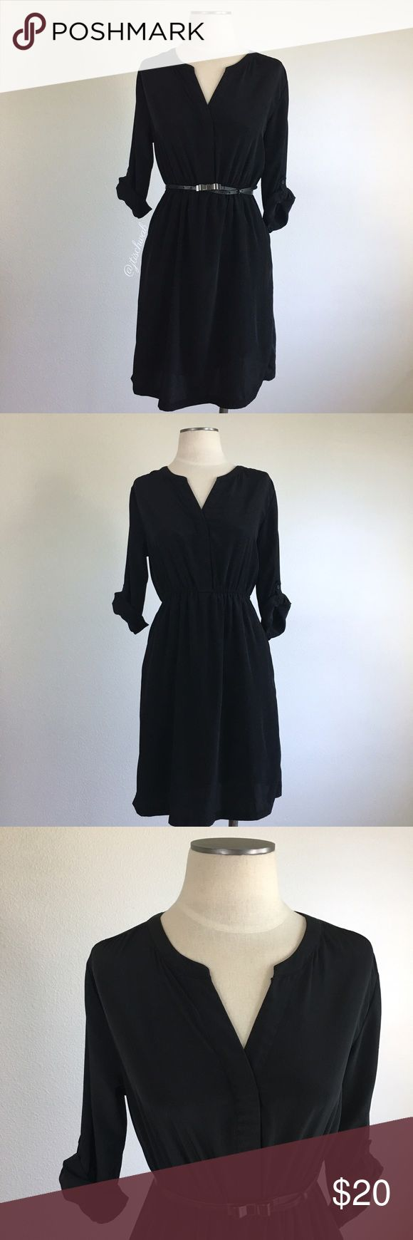 "Old Navy- Black Tab Sleeve Shirtdress SZ M Old Navy- Black Tab Sleeve Shirtdress SZ M. Hidden buttons (3), slips over the head. Skirt is lined. Side pockets. Sleeves are 3/4 & roll up, fastens w/a button. Dress is 36"" long (I'm 5'7"" and it hits past my knees). Armpit-armpit measures about 18"" across laid flat. Elastic waist measures about 13.5"" across unstretched. Fabric is a smooth substantial material (not see through). 100% Polyester. Preloved but still great condition. Belt pictured is…"