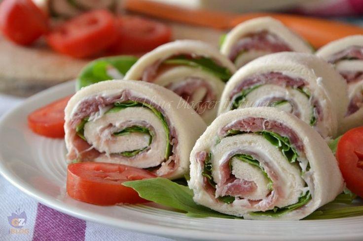 girelle salate con pancarrè per tramezzini, facili, veloci, versatili e appetitose, variate il ripieno come più vi piace, con prosciutto crudo e rucola.