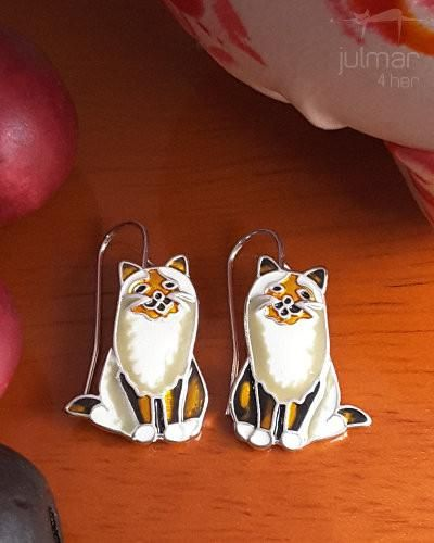 Exclusively designed by Marilyn Grame these cat-shaped silver plated earrings have been hand-painted with colourful enamels by talented artisans. The cat lover will appreciate the inclusion of silver whiskers making these a distinctive pair of earrings ready to be shown off. Free Express Shipping within Australia