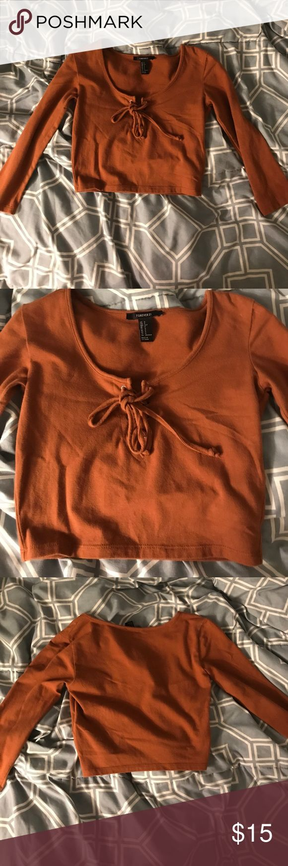 Lace up camel crop top Perfect condition, never worn crop top. 3/4 sort of sleeve length. Tops Crop Tops