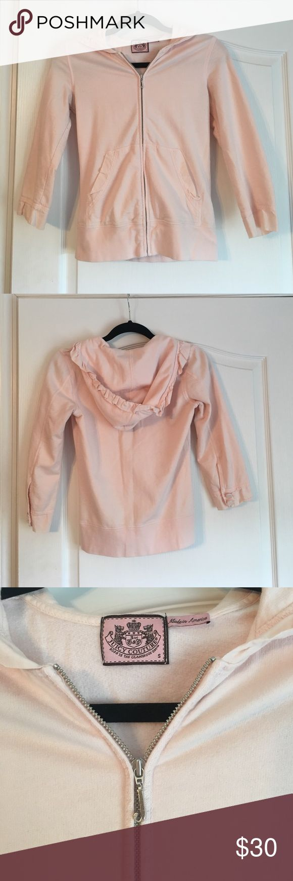 Juicy Couture light pink sweatshirt Juicy Couture light pink 3/4 sleeved sweatshirt. Ruffled hood and button detail on sleeves Juicy Couture Tops Sweatshirts & Hoodies
