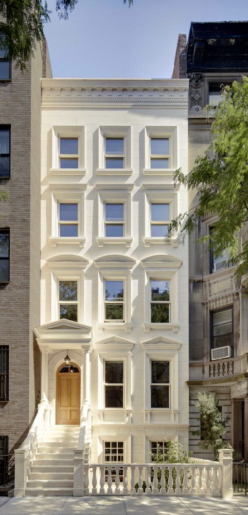 Four-story and basement townhouse with a set-back fifth floor in the Upper East Side Historic District, NYC, New York