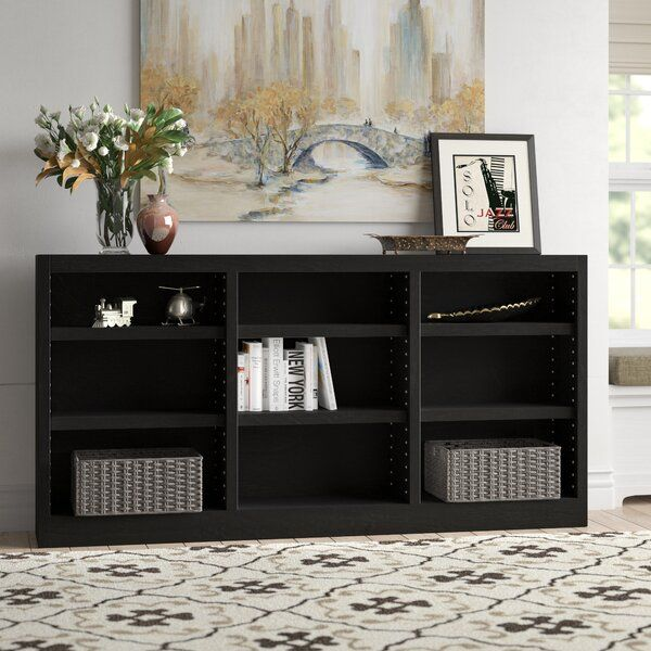 The Concepts In Wood 9 Shelf Triple Wide Bookcase Has A