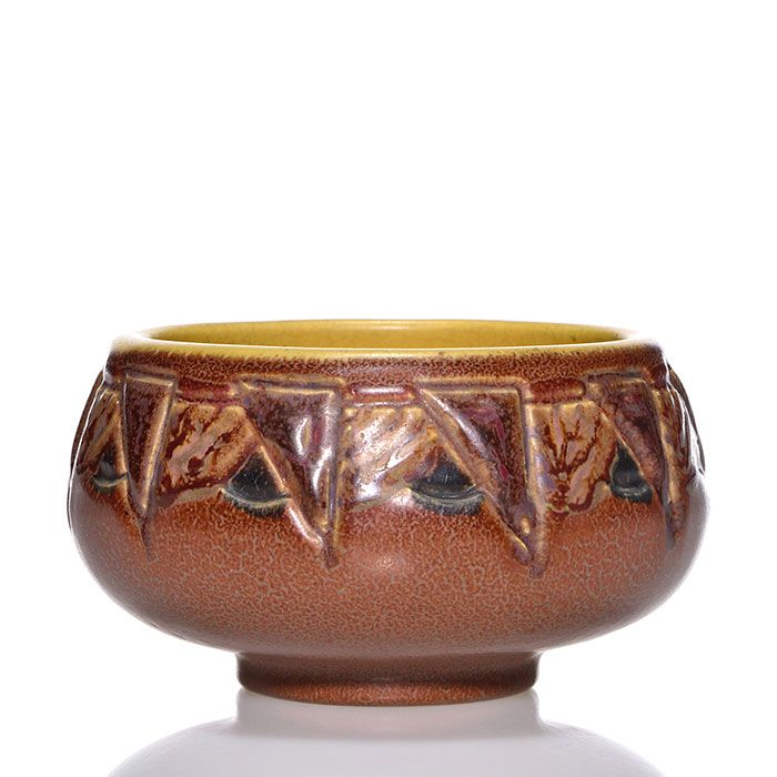 Rookwood Pottery  Ombroso bowl with carved fruit and geometric patterns done by C.S. Todd in 1917. Marks include the company logo, the date, shape number 1842 and Todd's incised initials Height is 3 inches and width is 5 inches.