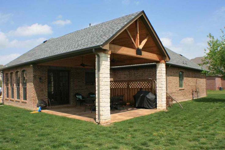 Covered patio ideas this covered patio was built with a for Front porch hip roof designs