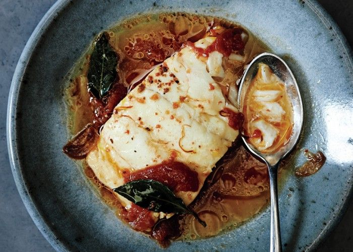 Poached Cod with Tomato and Saffron - Bon Appétit - use better quality fish next time. Nice and easy. Serve with crusty bread.