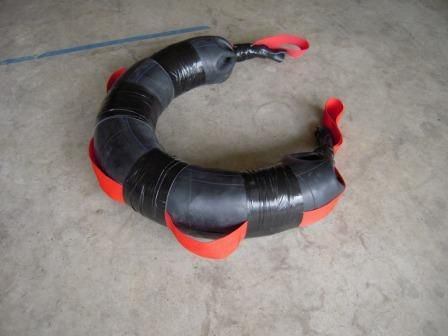 A homemade bulgarian training bag (sand bag) made from an old truck tire tube.
