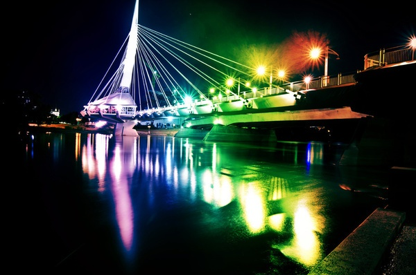 Provencher Bridge, Winnipeg, Canada illuminated at night. #Canada #travel #bridges