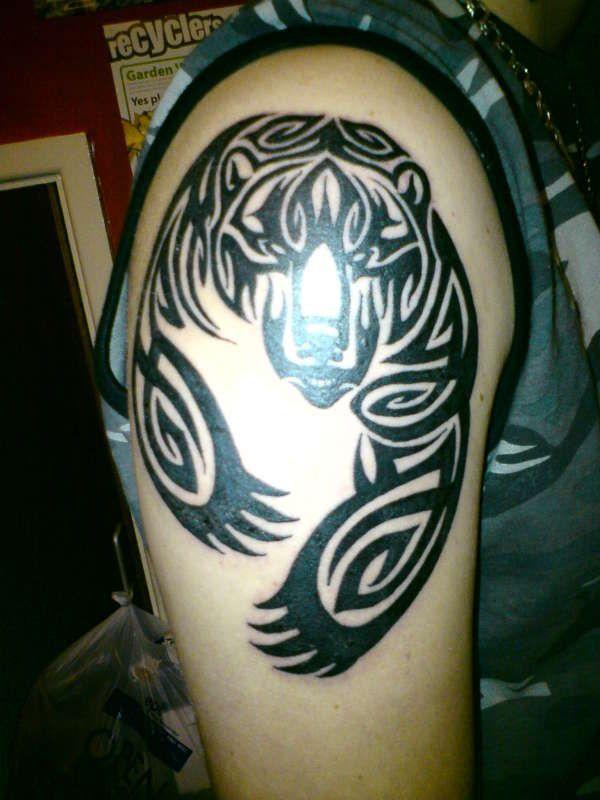 @Samuel Frame   tribal bear tattoo - brave