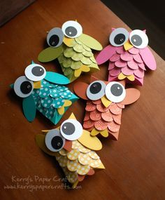 Owls - used toilet paper rolls and glued colors paper around them. pinched the top together which made it easier to fold down the heads.  left the bottoms open so the owls could stand up. didn't have a hole punch that big for the feathers so I used a quarter and traced around it and cut out a stack at a time.