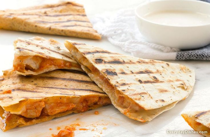 If you love the combination of gooey melted cheese and spicy buffalo wings, you're going to love our simple buffalo chicken quesadillas recipe.