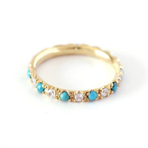 Full eternity ring with 2 mm diamonds and turquoise stones. The ring has an oriental/bohemian look. Can be a unique wedding ring or an anniversary