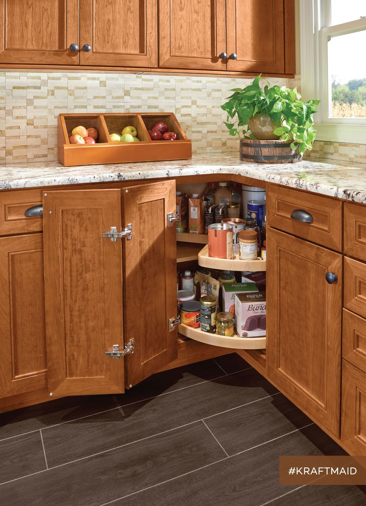 The base cabinet shelves in the wood super-susan revolve independently for easier access to items on the lower level. (cherry kitchen cabinets in Praline)