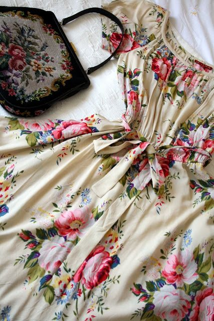 This is like the epitome of my style!Modest floral dress and a vintage cross stitch purse. Soooooo in love