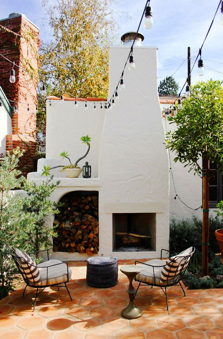 White ceramic fireplace in outdoor space