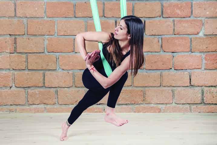 Prasarita Padottanasana Twist aerial yoga benefits  ...